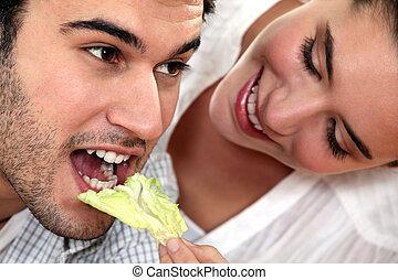 woman giving her boyfriend a salad