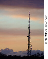 Communications mast 02 - Communications mast silhouetted...