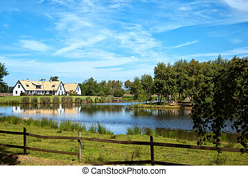 lakehouse - A view of a countryside lakehouse near the...