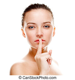 silence - Beautiful woman making silence sign. Isolated over...