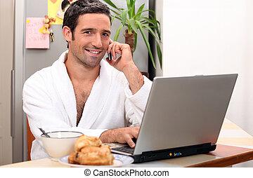 modern businessman having breakfast at home