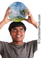 Young man smiling and holding ball with ecosystem