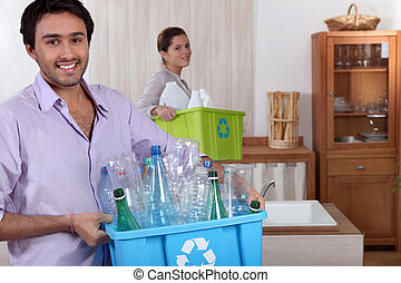 couple doing recycling