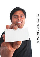 Indian young male holding business card on white background