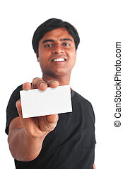 Young indian guy holding business card