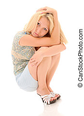 Pretty blonde squatting over white backround