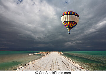 The balloon flying in a thunderstorm