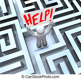 Person in Labyrinth Maze Holding Help Sign - A man stands...