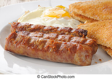 Suasage and eggs - A sausage and egg breakfast