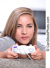 Young woman with video game controller
