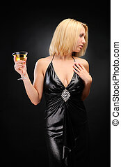 Sexy blonde standing with goblet, hand on chest