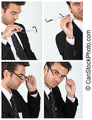 a manager taking his glasses