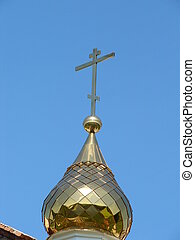 Orthodox Churchs Cupola with Holy Cross upon blue sky