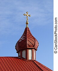 Orthodox Church's Cupola with Holy Cross upon blue sky