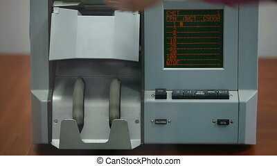Banknote Counter - Money counting machine counting ukrainian...