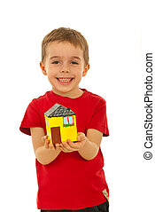 Happy boy offering a house