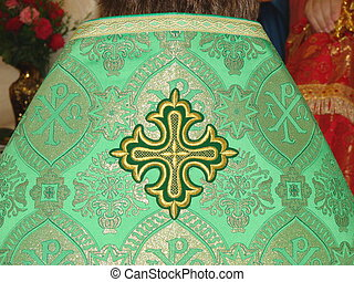 Holy Cross on slavic orthodox priest's green mantle