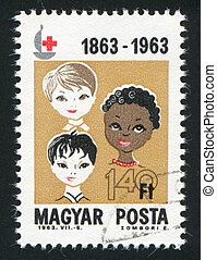 Boys of 3 races - HUNGARY – CIRCA 1963: stamp printed by...