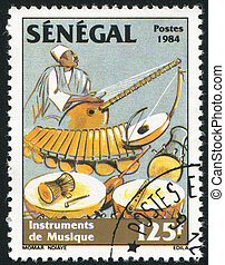 Musician playing balaphone - SENEGAL - CIRCA 1985: stamp...