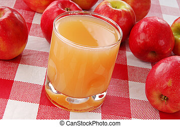 Unfiltered apple juice - A glass of unfiltered organic apple...