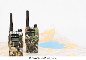 PMR radios and map - Two walkie-talkies and map on the...