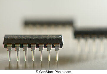 Microcircuits - Close up macro photo of 14 pin microcircuits