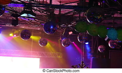 lighting equipment  at concert - colored spotlights on ceiling
