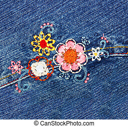 embroidery on denim - embroidered flowers on blue denim...