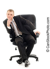 Boss - Young man sitting in chair. Isolated over white.