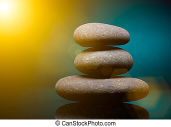Spa stones - Stack of spa stones over color background with...