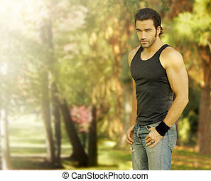 Male model in park setting - Outdoor portrait of a good...