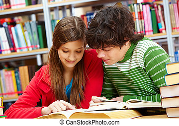 Happy readers - Friends spending time together studying at...
