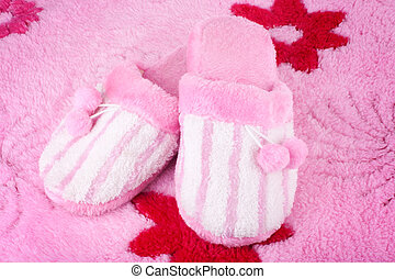 pink home slippers on fluffy bath rug