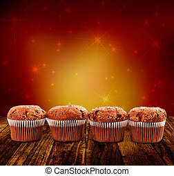 four chocolate muffins on artistice background