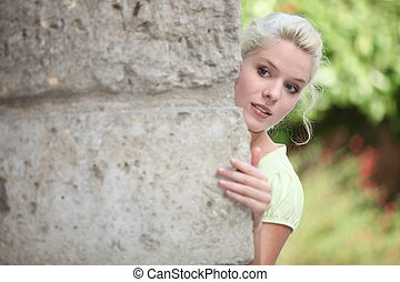 blonde playing hide-and-seek