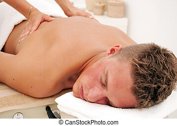 Man relaxed in spa - A young man relaxes as he enjoys a...