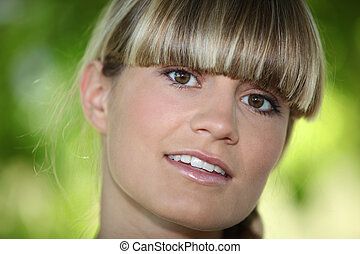 Girl with a blunt fringe outdoors