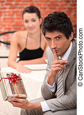 Man with a surprise present