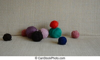 thread balls on the divan in the room