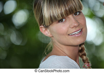 Young woman with a blunt fringe outdoors
