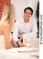 man and woman flirting in a restaurant