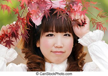 lolita portrait - japanese lolita portrait in park during...