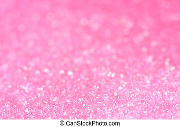 Pink sugar sparkle background with focus in the front