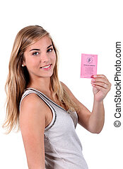 Blonde girl with a driving license