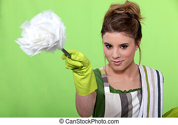 Young woman dusting