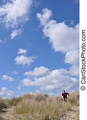 Sand Dunes at Studland - Boy running down the sand dunes