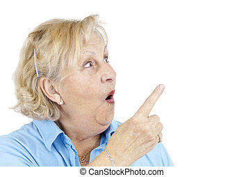 Shocked senior woman pointing - Funny senior woman with...