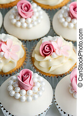 Wedding cupcakes - Cupcakes decorated with sugar roses and...
