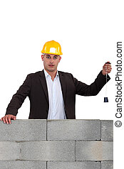 Builder using a plumb line