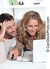 Couple on laptop.